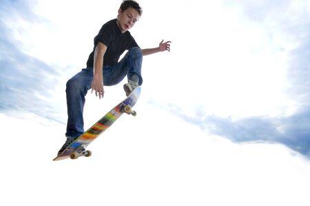 stunts: Boy practicing skate in a skate park  Stock Photo