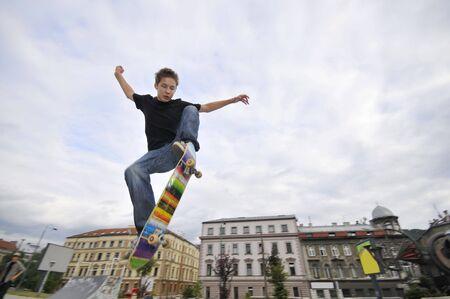 Boy practicing skate in a skate park  photo