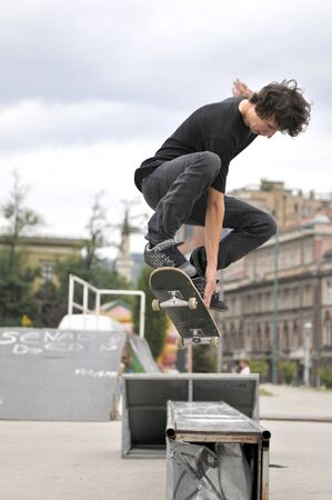 Boy practicing skate in a skate park  photo