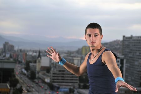 young man dancing and jumping on top of the building Stock Photo - 5332304