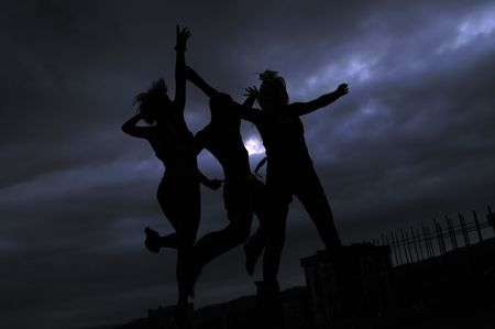 three teens jumping in air representing disco and pary, joy and fun concept photo