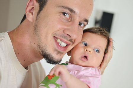 babby: indoor portrait with happy young famil and  cute little babby