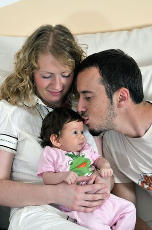 babby: indoor portrait with happy young family and  cute little babby