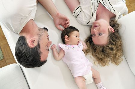 babby: indoor portrait with happy young family and  cute little babby Stock Photo