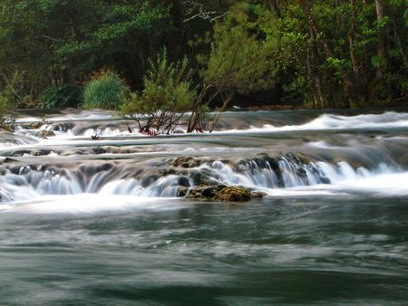 bosna and herzegovina: fresh water of clean wild river with waterfall in nature Stock Photo