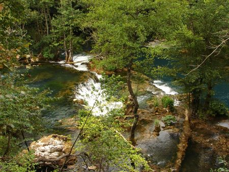 fresh water of clean wild river with waterfall in nature photo