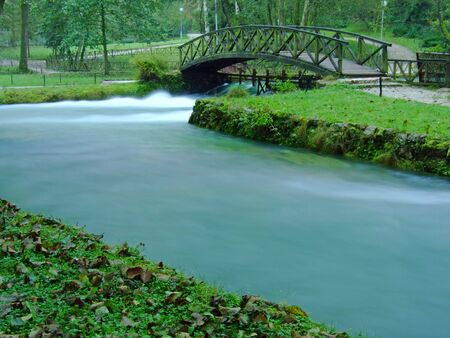 river and cute bridge in nature at morning with long exposure photo