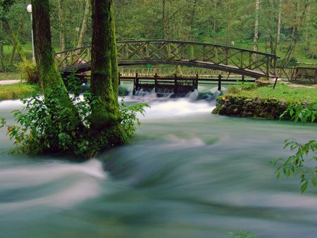 bosna and herzegovina: river and cute bridge in nature at morning with long exposure