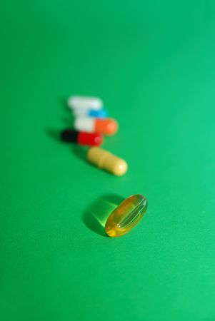 pills on green background photo