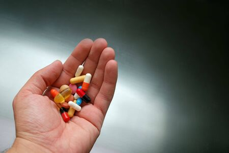 deleterious: pills in hand Stock Photo