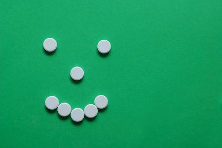 smiley simbol with white pills photo