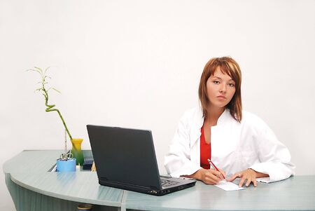 smilling: Smilling nurse with laptop Stock Photo