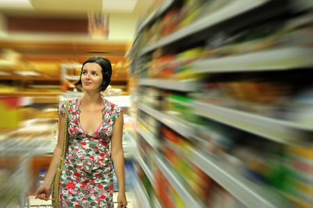 Young woman shopping in market with basket in hand Stock Photo - 5296096