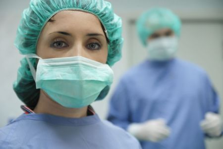 doctor mask: doctor team in surgery room Stock Photo