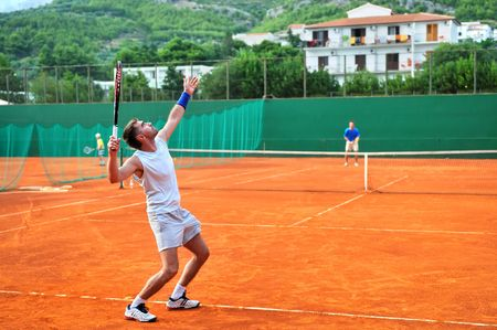 One man play tennis on outdoor court photo