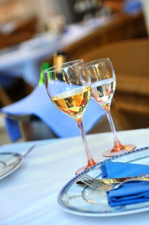Glass of white wine in luxery restaurant photo