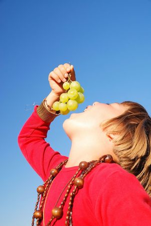 happy girl withy grape outside photo