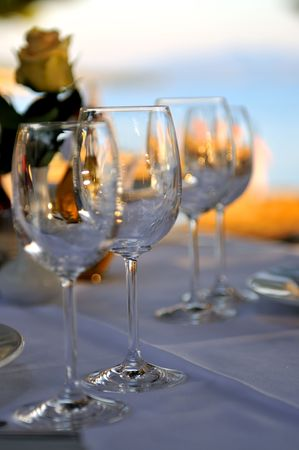 outdoor restaurant: empty vine glasses at outdoor restaurant  Stock Photo