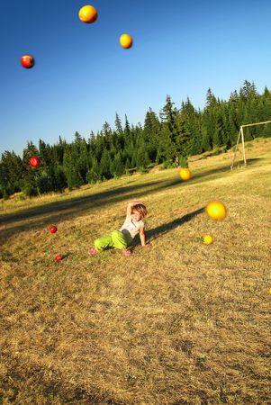 young happy girl throwing apple  photo
