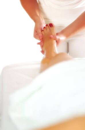 leg and foot massage at the spa and wellness center photo