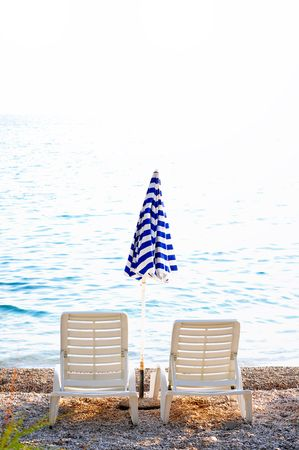 empty chairs on beach with umbrella Stock Photo - 5294183