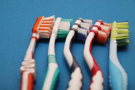 teeth brush on blue background photo
