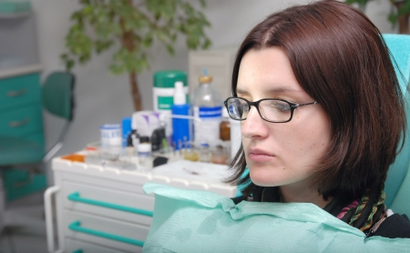 girl on dentist chair photo