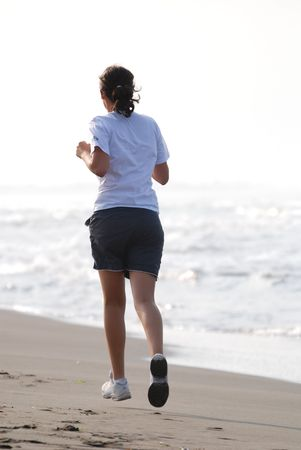 youg woman run outdoor on beach at early morning photo
