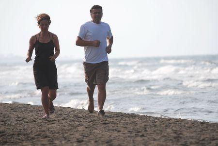 couple running on beach photo