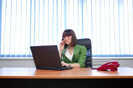 business woman working in office on laptop coomputer and papers and documents photo
