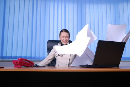 happy business woman in office  throw documents and representing freedom and antistress concept photo