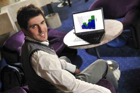 buisiness: Young buisinessman sitting and working on buisiness solution Stock Photo