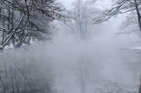 early mornig at beutiful winter day at river and lake photo