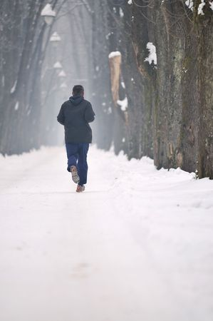 one older man running at alley on winter seasson at early morning Stock Photo - 5295512
