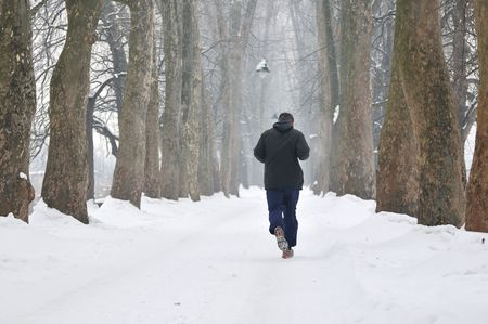 one older man running at alley on winter seasson at early morning photo