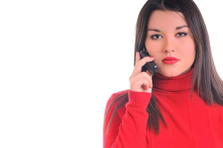 young business woman in red isolated on white talking on cell phone photo