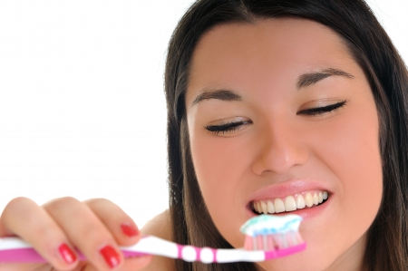 dental care concept with beautiful smilling young  woman and tooth brush photo