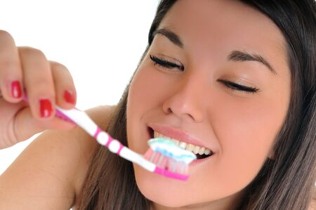 dental care concept with beautiful smilling young  woman and tooth brush Stock Photo - 5300066
