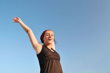 arms wide open: young happy woman with arms wide open representing freedom concept