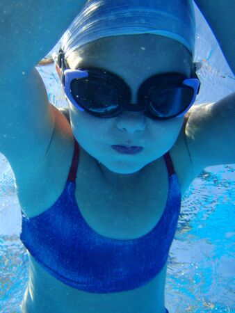 happy child play on swimming pool taken with underwater camera at summer season photo