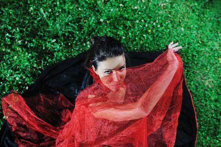 young beautiful bride in black wedding dress in dar at night  photo