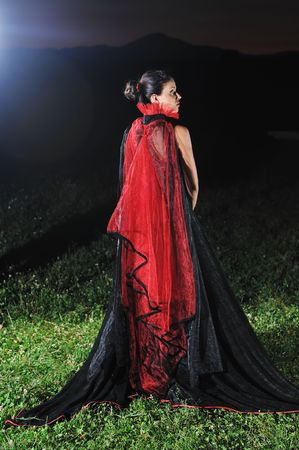 young beautiful bride in black wedding dress in dar at night  photo