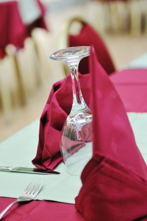 restaurant table with empty wine glass and red table decoration Stock Photo - 5446969