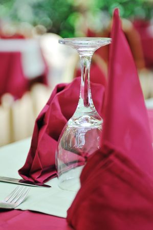 restaurant table with empty wine glass and red table decoration Stock Photo - 5446970
