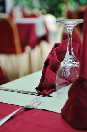 restaurant table with empty wine glass and red table decoration Stock Photo - 5446972