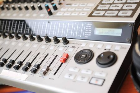 music studio mix table closeup photo