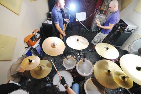 young music player and band friends have training in home garage photo