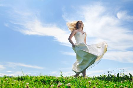 debutante: happy young beautiful bride after wedding ceremony event have fun outdoor on meadow at sunset