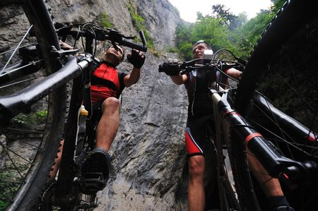 two friends have fun outdoor in nature and representing concept of  healthy life and fitnes on muntain bike  photo