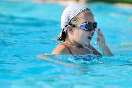 happy kids have fun on outdoor swimming pool at beautiful aquapark Stock Photo